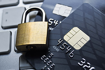 Credit cards and lock on laptop_CardinalCommerce