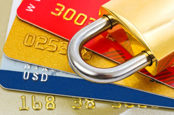 A lock on top of credit cards_CardinalCommerce